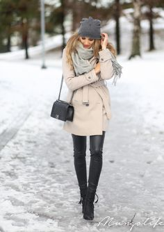 Anna Vanhanen is wearing black trousers from River Island, ankle boots and grey scarf from Acne, bag from Chanel, hat from Ebay and the coat is from Burberry