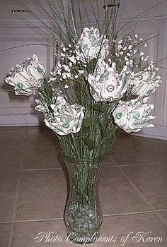 Dollar Bill Money Roses http://winonatong.com/archives/2005/09/how-to-make-a-money-rose.php