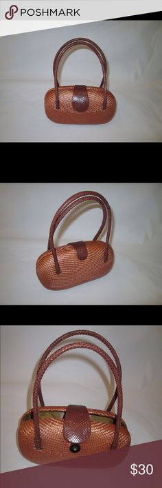 Bahay Bags brown woven Buntal  hard shell handbag A small hard shell rusty brown with dark leather handles handbag. The bag is made of Buntal which is a linen like natural fiber that is tightly woven to form the handbag. The leather straps have a snakeskin finish and the bag closes with a strong magnetic snap. The bag is lined in a quilted fabric with an elastic slip pocket.    In perfect condition, no stains or odors. Measurements:  8 1/2 inches wide, 5 inches tall, 3 inches deep, handles…