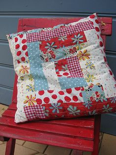 White, red, blue, and yellow log cabin pillow