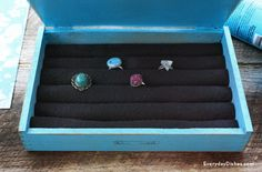 This DIY jewelry box is easy to make using a cigar box and keeps your rings organized.