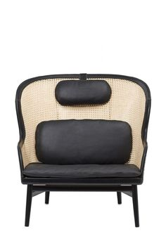 The 'Dandy' Chair: Easy chair with stand in beech. Back in rattan, lined with leather. Neck cushion and frame in Tarnsjo leather in black. Lumbar and seat cushion in leather. Cane Furniture, Rattan Furniture, Cheap Furniture, Rattan Chairs, Lounge Chairs, Furniture Nyc, Upholstered Chairs, Furniture Removal, Lounge Furniture