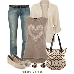 Very cute outfit with short sleeve heart shirt, denim jeans, cream colored cardigan.