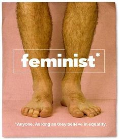 By using big, hairy male legs as its backdrop, this ad recontextualizes the stereotypical image of a feminist.