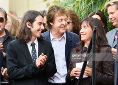 Olivia Harrison, the widow of George Harrison and son Dhani Harrison join Sir Paul McCartney (C) at the ceremony honoring George Harrison of The Beatles with a star on the Hollywood Walk of Fame on April 14, 2009 in Hollywood, California.