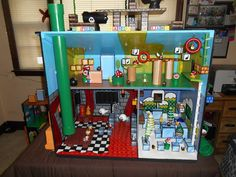 SUPER MARIO! I repurposed a doll house into a One-Of-A-Kind Mario Land playset for my son! All hand crafted and handed painted details. All functioning sides, details, and moving parts. Only things purchased were some of the figures. For more pictures look under my board. #Mario