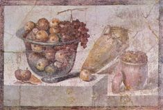 A still life with fruit basket and vases (Pompeii, c. AD 70).