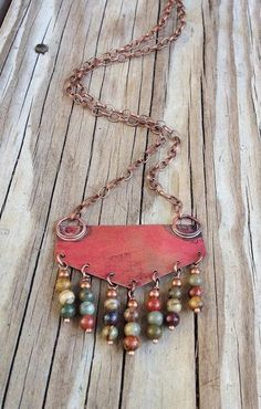 """Handmade Bohemian copper necklace with red creek jasper. Hand cut, soldered and oxidized copper with red creek jasper dangles. Pendant Approx 2"""" x 2"""" with dangles. Necklace length 18"""""""
