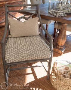 Rattan chair after I painted them with Rustoleum spray paint in Anodized Bronze.  For me, it's the perfect gray with brown undertones, which warms the color right up. Upholsterer made cushion for $35+ fabric cost