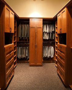 Charming Wood Walk In Closet By Classy Closets Featuring Symmetrical Hanging Space,  Drawers And Cabinets