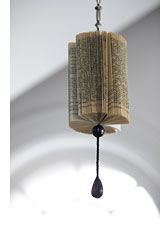 Use a loosely fan-folded book to adorn basic items around your home and add intrigue to all sorts of spaces. With glue or paper clips, you can attach the last pages of your book together to create a cylinder, then use it to adorn a fan pull, accent a hanging lamp, or hang or place a group of different but similar sizes and shapes for a table decoration.