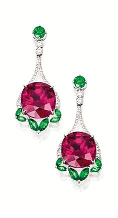 PAIR OF PINK TOURMALINE, TSAVORITE GARNET AND DIAMOND PENDANT EARRINGS Each suspending on an oval pink tourmaline weighing 10.59 and 10.42 carats respectively, surmounted and anchored by marquise-shaped and circular-cut tsavorite garnets altogether weighing approximately 2.65 carats, to the stylised frame set with brilliant-cut diamonds, mounted in 18 karat white gold.
