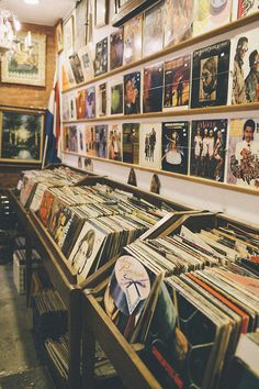 Record store, where you used to sit down and use the headphones to listen to the records before you decided to buy them :)