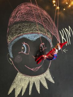 Our Elf on the shelf 2017. Loving their art work on our chalkboard wall  #elfontheshelf #elfontheshelfideas #elf #christmas #blackboard #chalkboard #chalkboardart