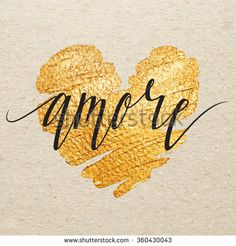 Italian Valentines day card. Amore calligraphy lettering with gold paint heart on craft background. Hand drawn letters.