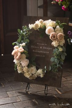 gorgeous rose wreath reception presentation board
