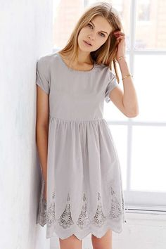 Pretty gray dress with cute scalloped hemline.