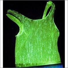 - LumiTop Karina (luminous fiber optic fabric T-Shirt) Smart Textiles, E Textiles, Fiber Optic Lighting, Party Tops, Fabric Decor, Creations, Glow, Clothes, Technology