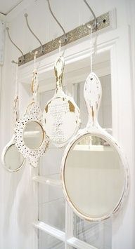 If you have an empty spot on your wall or just want to hang something pretty over your window, hang vintage mirrors from old hooks. Shabby and decorative.