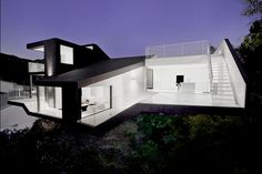 Elegant and Abstract House Design with Paint Black and White by XTEN Architecture