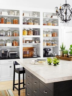 Beautifully organized kitchen with food stored in individual glass jars