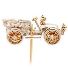 Antique Tiffany & Co. Diamond Gold Platinum Car Tiepin | From a unique collection of vintage brooches at https://www.1stdibs.com/jewelry/brooches/brooches/