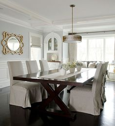Blue gray walls in Dining. Slipcovered chairs, mirror and chandelier. gildedmint.blogspot.com