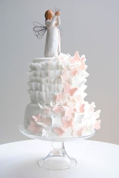 I like the way the butterflies sit on the ruffles and the use of the willow tree figurine. I'd use a different figurine but it goes well as a cake topper and doubles as a gift :)