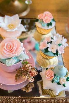 Don't miss this pretty garden birthday party! The cupcakes are gorgeoys! See more party ideas and share yours at CatchMyPartyy.com #catchmyparty #partyideas #gardenparty #spring #teaparty #girlbirthdayparty #cupcakes