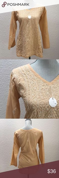 Pale orange handmade sequined/embroidered blouse NWOT What a beautiful pale orange/peach tunic this is! It recently traveled straight from the artist in India. Crocheted detail, hand embroidery and sequins throughout. This lovely will fit a standard small and has a straight fit throughout.  It has two slits, one on each side. 100% cotton. Bust 42 in, Hip 42 in. Handmade in India Tops Blouses