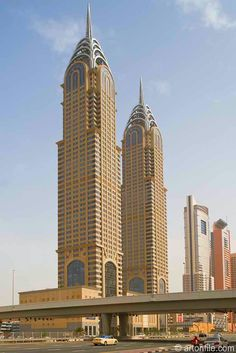 Dubai twin towers pay tribute to the Art Deco classic Chrysler Building.