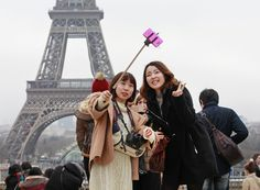 Why would you spoil a good picture of the Eiffel Tower with your stupid face on it? Tourists shoot a photo using a selfie stick at the Trocadero, across the River Seine from the Eiffel Tower, in Paris. While the devices have become e. Stupid Face, You Stupid, Empire State Building, Big Ben, Japanese Inventions, Selfies, Paris Torre Eiffel, Most Satisfying Video, Sites Touristiques
