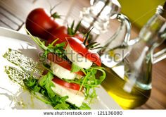 Caprese salad, italian appetizer with mozzarella and tomatoes by MilaCroft, via ShutterStock