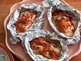 salmon baked with chopped tomatos, shallots, lemon juice, oregano, and thyme yummy!!