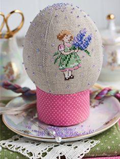Snow globe egg with cross stitch