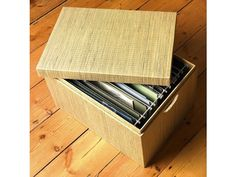 Our Mendong Foolscap File Box is made exclusively for The Holding Company. A heavy duty card base is covered in woven mendong grass with metal rods inside to hang standard foolscap suspension files. This lidded box has useful cut-out carry handles.  These best-selling filing solutions are the perfect way to get your Living room organised.