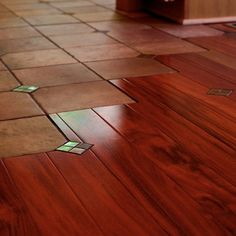 Super cool tile to wood floor transition.  Great way to transition so it does not look so strange.