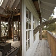 Chicago woodworkers and designers used salvaged and gathered materials to build this modern, rustic tree house at Camp Wandawega in Wisconsin.