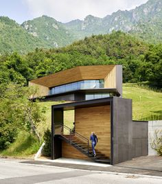 A panoramic window surrounded by a faceted wood and corrugated copper frame  dominates the facade of this Alpine residence by Camillo Botticini  Architetto 4a8a1697cba6