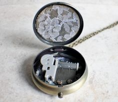 Dragons Breath, Music box locket, round locket with music box inside, in silvertone with dragons breath glass opal and bronze accents
