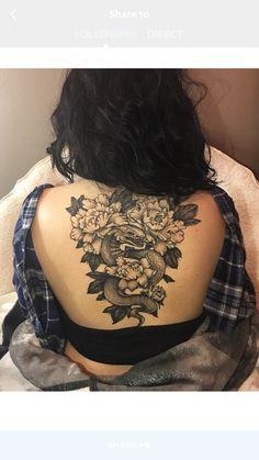 Woman's back tattoo , snake , peony