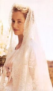Queen Paola's veil from her Italian noble family, is a Belgian work of art, and was originally worn in 1877 by her Belgian grandmother, Laura Mosselman du Chenoy, when she married Don Beniamino, Prince Ruffo di Calabria, and it is made of 10 ft of Brussels lace. Queen Paola's mother wore the veil at her wedding before it returned to Belgium when Paola wore it to marry Prince Albert. Since then, it has been worn by her daughter, Astrid, and her daughters-in-law, Mathilda and Claire.