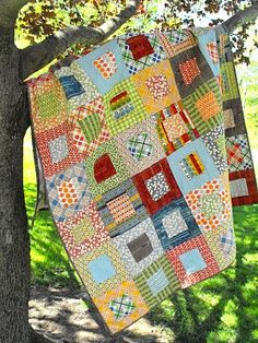 Square in Square Quilt. Love the straight line grid quilting.