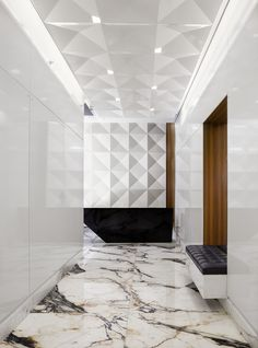beautiful marble floor, built-in bench niche, tufted black leather bench, wood clad niche, relief pattern wall tile, Mulberry House
