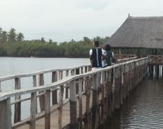 water - lake - bridge - wood - hut - piles - stilts - people - man - woman - child - baby - trees - forest - canoe - relaxation - holidays