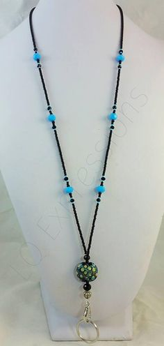 New Bargain Designs- same high quality as you would expect with LQ Expressions!! All LQ lanyards are easy to change out, Keys/ID Holder can easily be clipped and un-clipped to change your work jewelry daily! Easy to wear and work in your wardrobe!! This lanyard has great colors!