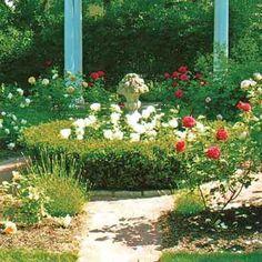 formal garden with urn decorating center flower bed