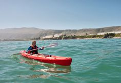 Photo about Young man in sea kayak against mountains. Shot in Hermanus during the whale watching season, Western Cape, South Africa. Whale Watching Season, Whale Watching Tours, Marine Reserves, Island Tour, Once In A Lifetime, Day Hike, Top Of The World, Africa Travel, Months In A Year