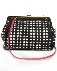 Black and White Handbag. The pink strap adds a fun color pop