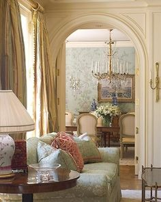 I like the arched doorway (and detail), the traditional/romantic style, the chandelier and wallpaper in the dining room, and the comfortable vibe